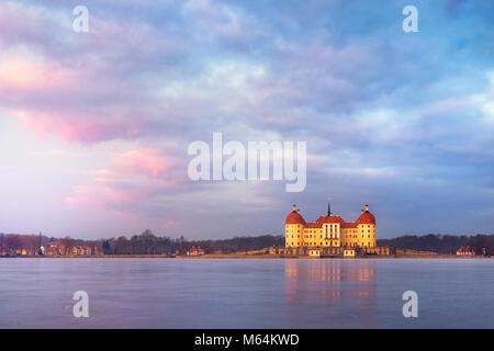 Moritzburg castle after sunrise at winter time, Germany - Stock Image