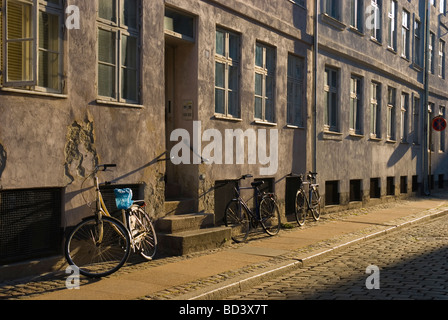 Parked bicycles early morning Copenhagen Denmark Europe - Stock Image