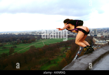 UK Naked BASE 1 BASE Jumping naked off Hilton Hotel Hyde Park London Great Britain jump jumper extreme sports illegal - Stock Image