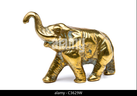 Brass Elephant statue from low perspective isolated on white. - Stock Image