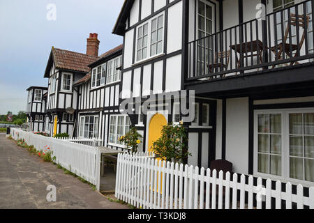 Tudor style terraced houses in Thorpeness, Suffolk, England, UK - Stock Image