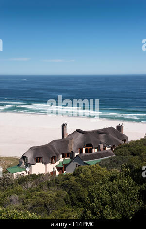 A beach lodge at Noordhoek Beach, seen from Chapman's Peak Drive, a suburb of Cape Town, South Africa. - Stock Image