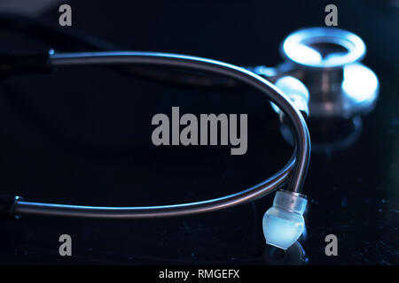 Doctors medical stethoscope used by doctor o nurse to listen to patient heartbeat in hospital. - Stock Image