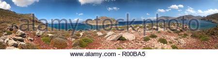 Panorama of rocks on hills by sea on Tilos, Greece - Stock Image
