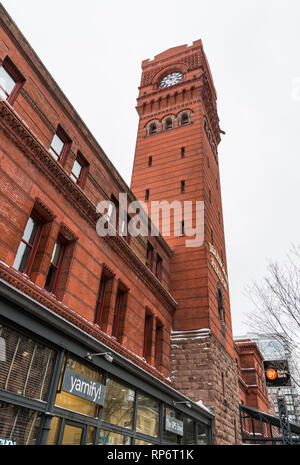 The clock tower on the Dearborn Station, a signature red brick building in downtown Chicago, Illinois, USA. - Stock Image