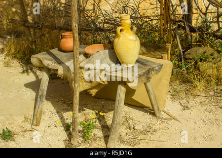 A small rough wooden table in the open air museum of Nazareth Village Israel. This site provides an authentic look at the life and times of Jesus in 1 - Stock Image