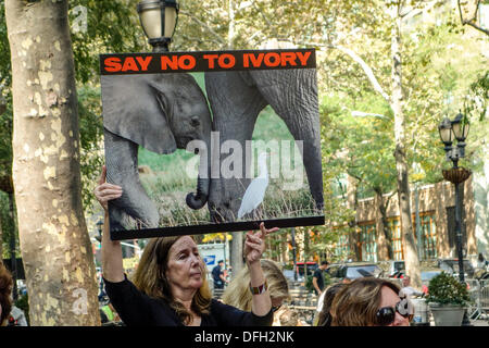 New York, NY, USA. 4th Oct. 2013. Supporters of iWorry march in a campaign to stop the killing of elephants for their ivory tusks. They head for the United Nations to present a letter calling for stricter penalties and a change in global policies regarding the killing of elephants and the sale of ivory. The David Sheldrick Wildlife Trust has organized the iWorry marches in 15 cities across the globe in the single largest demonstration of awareness for elephants. Credit:  Paulette Sinclair/Alamy Live News - Stock Image
