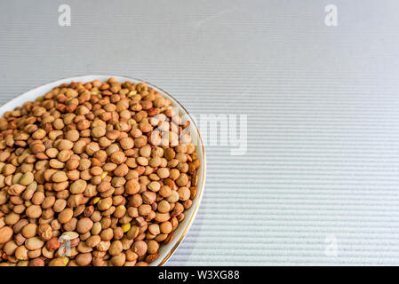 Bowl full of lentils with copy space - Stock Image