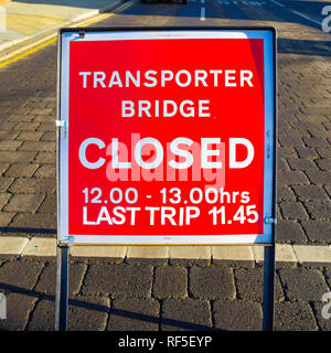 Sign at the approach to the Middlesbrough Transporter bridge indicating a one hour suspension of service - Stock Image