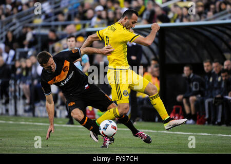 Mapfre stadium, USA. 23rd April, 2016. .Columbus Crew SC forward Justin Meram (9) and Houston Dynamo forward Andrew - Stock Image