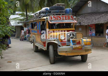 Transportation: jeepneys on the streets of the village El Nido. Philippines. El Nido (officially the Municipality - Stock Image