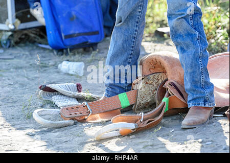 Native cowboy in the warm-up arena at the Tsuut'ina  Annual Rodeo & Powwow - Stock Image