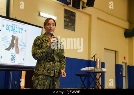180826-N-RM440-1413 MANAMA, Bahrain (Aug. 26, 2018) Rear Adm. Michelle C. Skubic, commander, Naval Supply Systems Command and Chief of Supply Corps, gives a speech during a Women's Equality Day celebration on Naval Support Activity Bahrain. Women's Equality Day commemorates the 1920 passage of the 19th Amendment to the Constitution granting women the right to vote. (U.S. Navy Photo by Mass Communication Specialist 2nd Class Samantha P. Montenegro/Released) - Stock Image