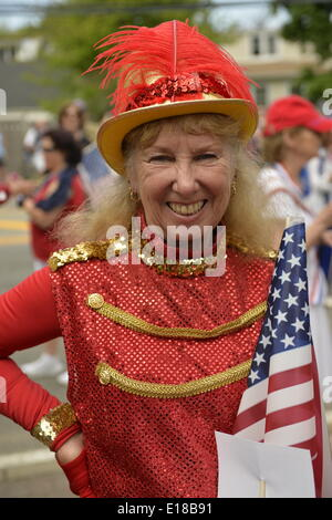 Merrick, New York, U.S. - May 26, 2014 - Senior dancers in red costumes marched in the Merrick Memorial Day Parade and Ceremony, hosted by American Legion Post 1282 of Merrick, honoring those who died in war while serving in the United States military. Credit:  Ann E Parry/Alamy Live News - Stock Image