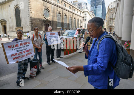 London, UK. 13th August 2018. Protesters outside the offices of Investec. Three days before the 6th anniversary of the massacre when 34 striking miners were shot dead by South African police at Lonmin's Marikana platinum mine, a tour of the City of London visited investors, insurers and shareholders profiting from the violence against people and nature in Marikana and heard about the colonial roots of the huge wealth of the City. Credit: Peter Marshall/Alamy Live News - Stock Image