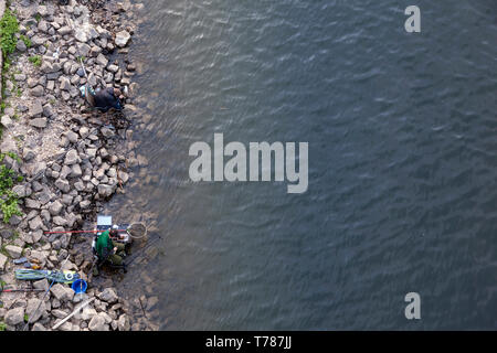 Angler on the banks of the Rhine - Stock Image