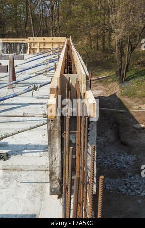Construction of a new building, installation of metal structures in the base of the wall - Stock Image
