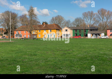Bures UK, view of the village green and colourful houses in Bures Hamlet on the Essex side of the village of Bures (Suffolk) England, UK. - Stock Image