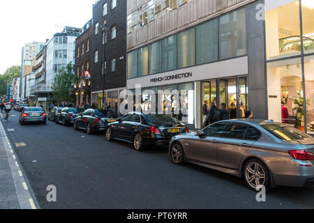 Cars parked outside the French Connection, London, UK, Europe. - Stock Image