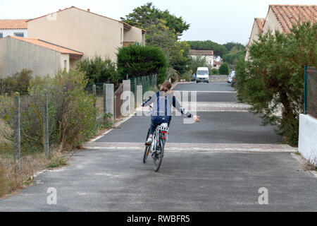 France, 2018, A Girl enjoying herself on a bicycle. - Stock Image