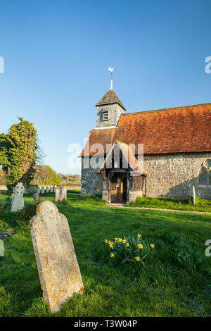 Spring morning at St Mary's church in Binsted village, West Sussex, England. - Stock Image
