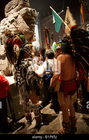 Shamen in Front of the Statue of Coatlicue at an Aztec Celebration in the National Museum of Anthropology, Mexico - Stock Image