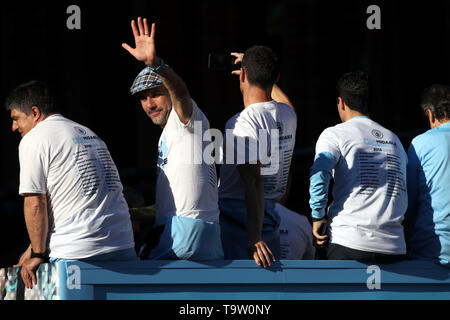 Manchester City manager Pep Guardiola waves to the crowds during the trophy parade in Manchester. - Stock Image