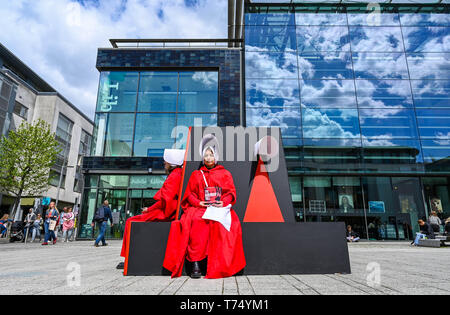 Brighton UK 4th May 2019 - The Handmaids Tale audio can be heard in Jubilee Square at the Brighton Festival Fringe 'Streets of Brighton' event in the city centre on the opening day. Credit: Simon Dack / Alamy Live News - Stock Image