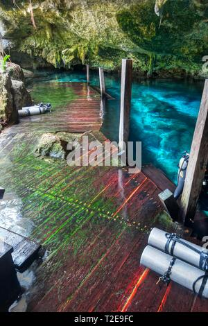Wood Staircase and Diving Oxygen Bottles in Cenote Dos Ojos (Two Eyes) Underground Fresh Water Cavern near Tulum Mexico on Yucatan Peninsula - Stock Image