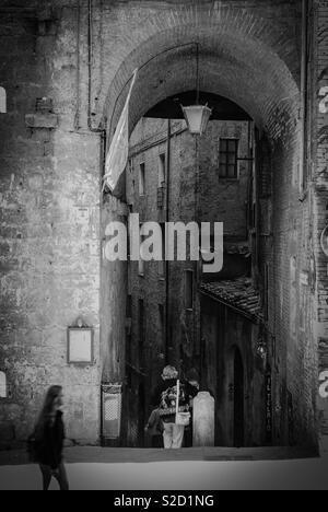 Street scene in Siena, Italy - Stock Image