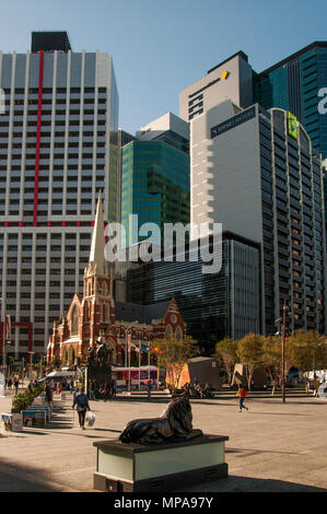The heritage-listed Albert Street Uniting Church (1889) contrasts with surrounding office towers at Town Hall Square, Brisbane, Queensland, Australia - Stock Image