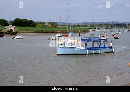 Topsham, Devon, UK. Topsham's Turf Ferry boat, Sea Dream II, is manoeuvring at the River Exe to dock, ready to pick up new passengers - Stock Image