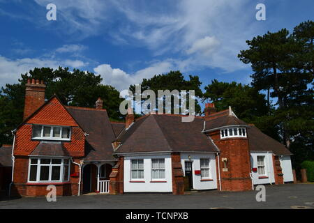 The old cottages, now used as offices, in the block beside the mansion at Bletchley Park, Milton Keynes, Buckinghamshire, UK. - Stock Image