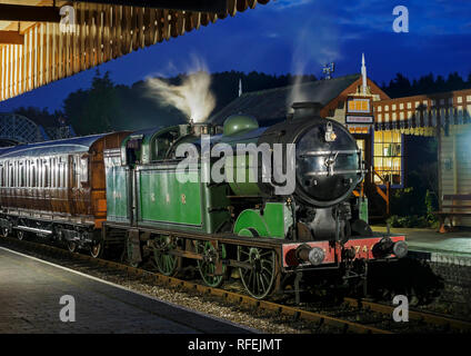 Ex GNR N2 class loco and a Gresley designed Quad-Art set of articulated suburban carriages recreate a commuter train from the mid-1920's. - Stock Image