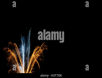 Elegant gold & white fireworks night sky black background New Years Eve New Year's Day Fourth of July Independence - Stock Image