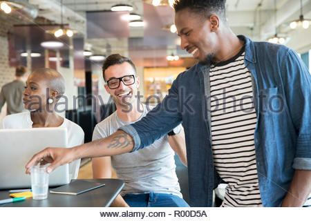 Colleagues smiling - Stock Image