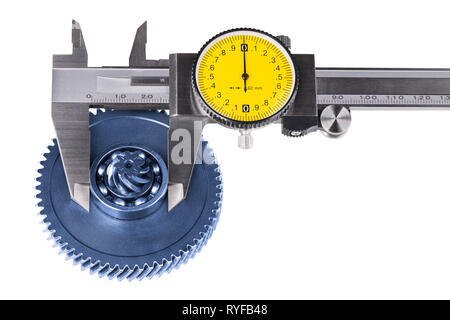 Measurement of cogwheel diameter by caliper. Isolated on white background. Silvery measuring tool. Round yellow dial. Metal gear, ball bearing.Quality. - Stock Image