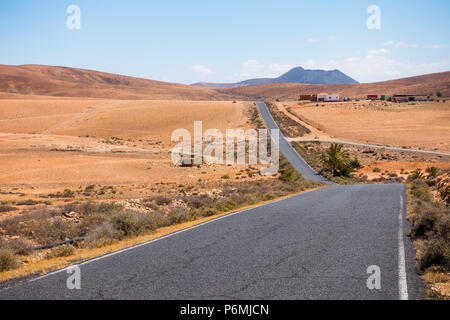 Road on the desert in Feurteventura on Canary Islands - Spain - Stock Image