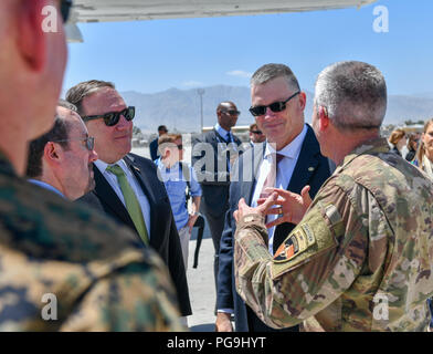 U.S. Secretary of State Michael R. Pompeo chats with U.S. Ambassador to Afghanistan John Bass and General John Nicholson upon arrival to Bagram Airfield on July 9, 2018. - Stock Image
