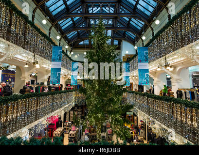 Princes Street, Edinburgh, Scotland, United Kingdom 5th December 2018. Jenners Christmas Tree is an Edinburgh institution. The 40 foot Christmas tree fills the centre of the grand Victorian balconied shopping gallery - Stock Image
