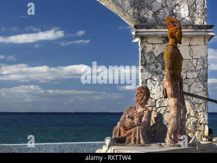 Mayan Woman Aztec Warrior Bronze Sculpture Cross Breeding Monument Public Art on Cozumel Mexico Waterfront - Stock Image