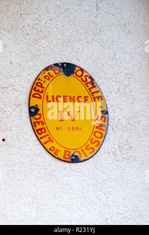 Moselle, France December 30 2013 : Vintage bar licencing sign in Moselle, France translated as 'Department of Moselle, Licence four, No 2891, Bar - Stock Image