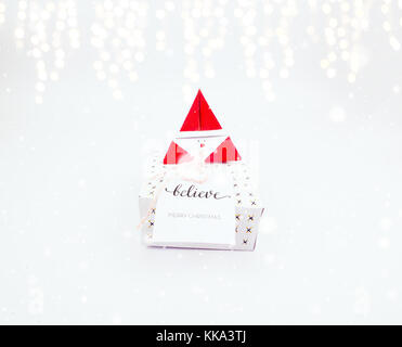 Christmas decoration square gift box for celebration with snow falling and golden bokeh best Christmas holidays - Stock Image