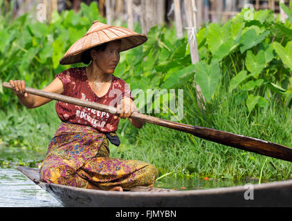Woman in a wooden canoe, 'Inle Lake', Myanmar, Asia - Stock Image