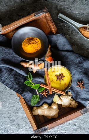 Easy to make healthy drink, turmeric golden milk in a jar - Stock Image