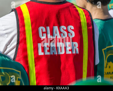 Person wearing a 'Class Leader' vest. - Stock Image