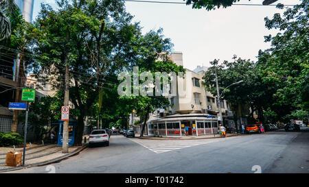 Rio de Janeiro, Brazil - March 16, 2019: Wide angle view of a street corner in up-market South Zone neighbourhood of Leblon in Rio de Janeiro - Stock Image
