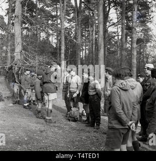 1960s, historical, scouts in the forest at an outdoor activity course, England, UK. - Stock Image