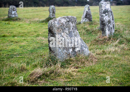 Some of the standing stones that make up the late Neolithic stone circle known as the Merry Maidens in Cornwall, England, UK - Stock Image