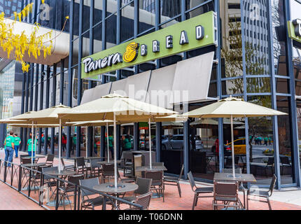 CHARLOTTE, NC, USA-3/16/19: A Panera Bread restaurant in uptown Charlotte, with sidewalk seating. - Stock Image